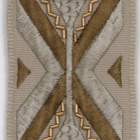Photo of the fabric Yin Ribbon Gold swatch by Mokum. Use for Trim. Style of Decorative, Pattern