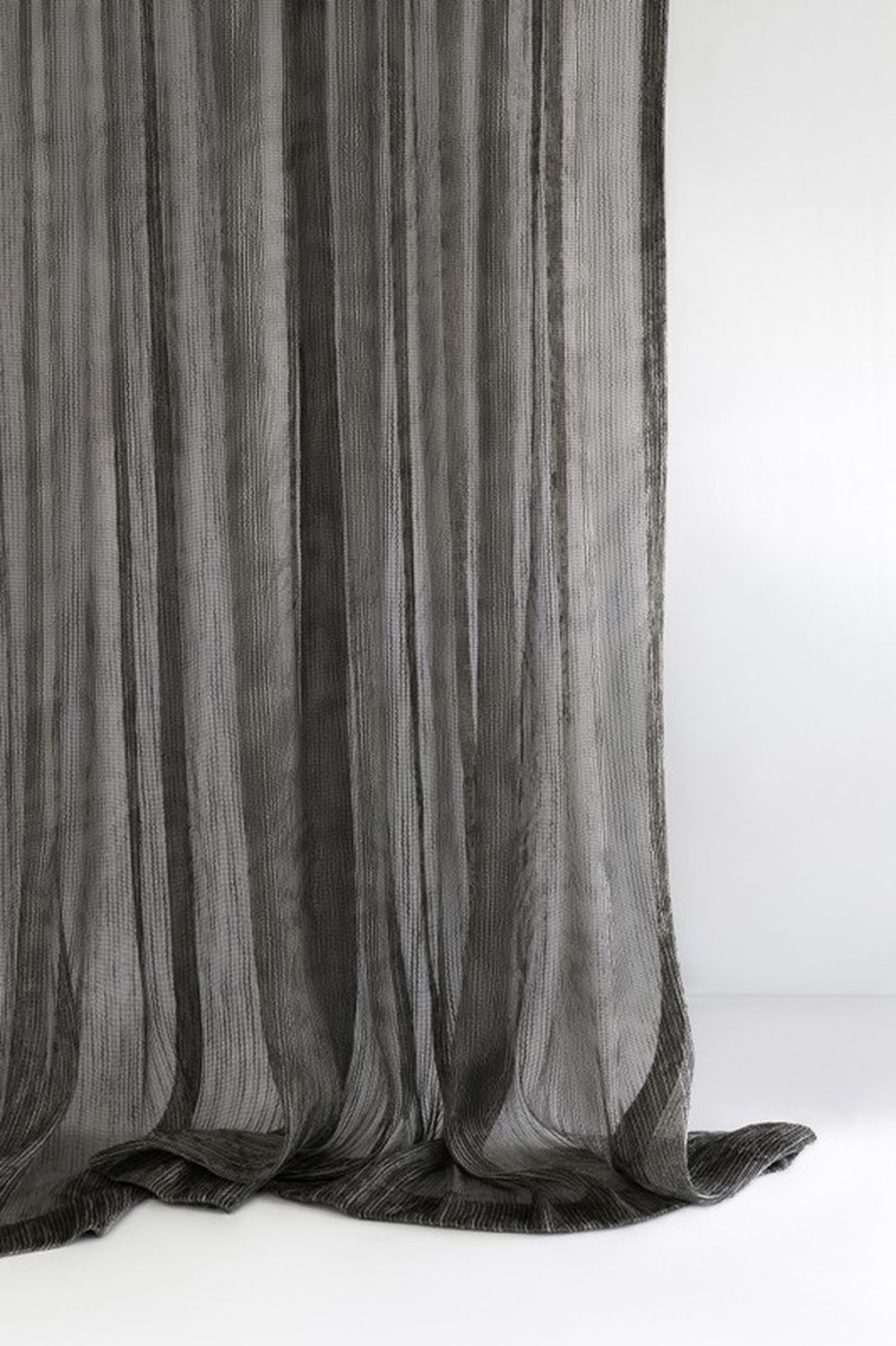 Photo of the fabric Hessian* Black Birch in situ by Mokum. Use for Drapery Sheer. Style of Abstract, Pattern, Sheer, Texture