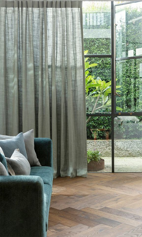 Photo of the fabric Simplicity* Sage in situ by James Dunlop. Use for Curtains, Accessory. Style of Plain, Texture
