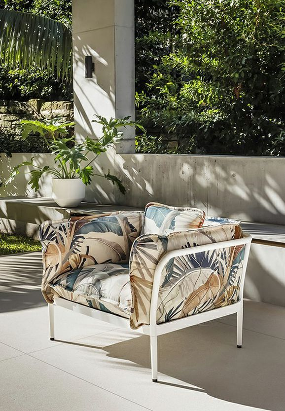 Photo of the fabric Tropicalia Coral in situ by Catherine Martin by Mokum. Use for Upholstery Heavy Duty, Accessory. Style of Decorative, Floral And Botannical, Pattern, Print