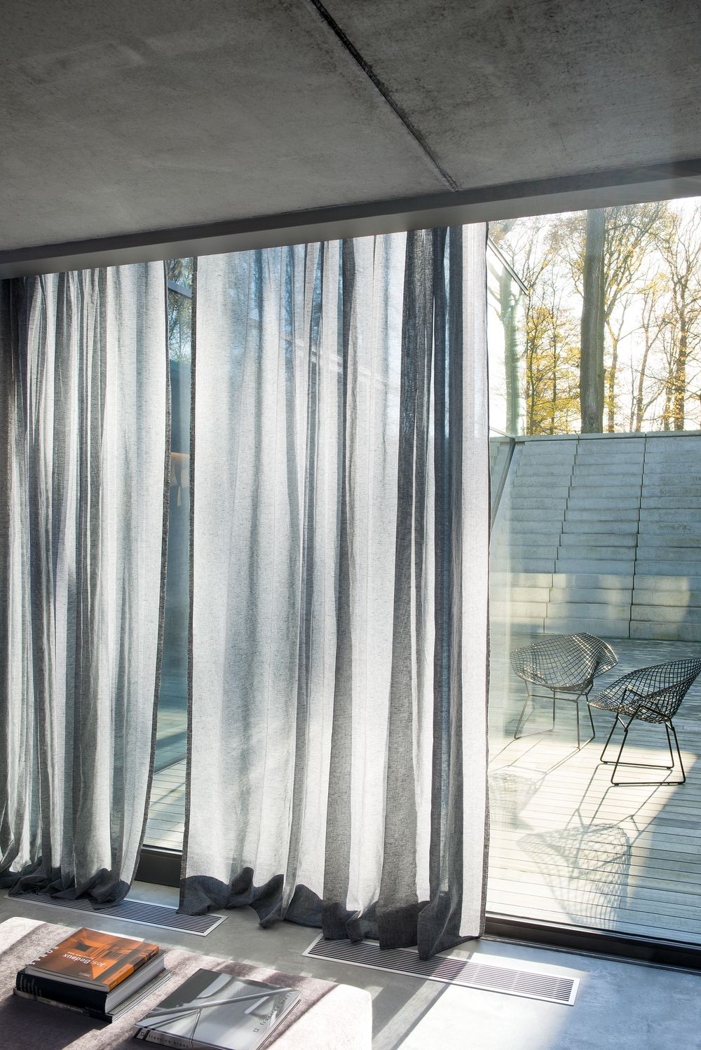 Photo of the fabric Allusion Silver in situ by Zepel. Use for Sheer Curtains. Style of Plain, Sheer