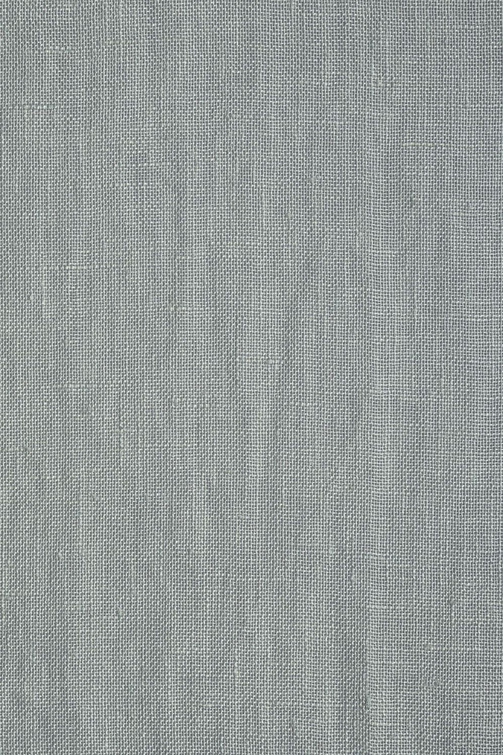 Photo of the fabric Kanso Stonewash Sky swatch by Mokum. Use for Curtains. Style of Plain
